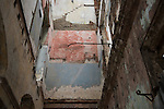 HAVANA, CUBA -- MARCH 24, 2015:   The interior of a deteriorated building in Havana, Cuba on March 24, 2015. Photograph by Michael Nagle