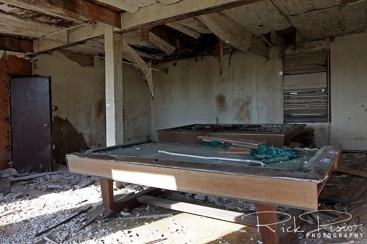 A pair of pool tables sit in an abandoned building at the closed Mare Island Naval Shipyard near Vallejo, California.