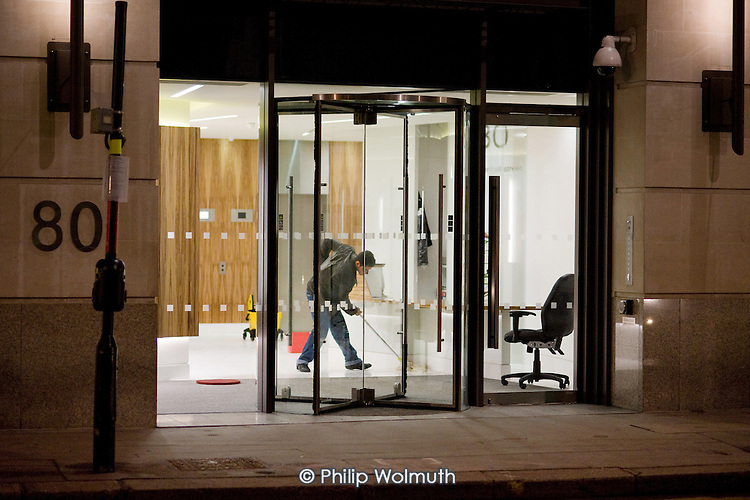 Cleaner on a night shift in corporate offices in the City of London