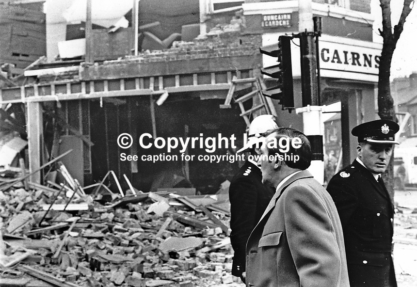 Scene of Provisional IRA explosion at the furniture store in Duncairn Gardens, Belfast, N Ireland, owned by the city's current Lord Mayor, Alderman Joseph Cairms (in light overcoat). 27th November 1971. 197111270943<br /> <br /> Copyright Image from Victor Patterson,<br /> 54 Dorchester Park, Belfast, UK, BT9 6RJ<br /> <br /> t1: +44 28 90661296<br /> t2: +44 28 90022446<br /> m: +44 7802 353836<br /> <br /> e1: victorpatterson@me.com<br /> e2: victorpatterson@gmail.com<br /> <br /> For my Terms and Conditions of Use go to<br /> www.victorpatterson.com