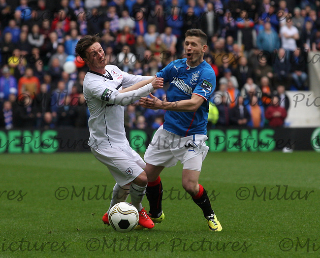 Joe Cardle  (left) and Fraser Aird  collide in the Raith Rovers v Rangers Ramsdens Cup Final match played at Easter Road Stadium, Edinburgh on 6.4.14.