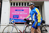 8th September 2017, Newmarket, England; OVO Energy Tour of Britain Cycling; Stage 6, Newmarket to Aldeburgh; Enthusiast's walk past a poster advertising the Tour of Britain