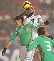 USA's Abby Wambach (C) heads the ball over Mexico's Alina Garciamendez (L) as Rubi Sandoval (R) looks on at Rio Tinto Stadium March 31, 2010 in Salt Lake City, Utah. The USA women won the match over Mexico 1-0.