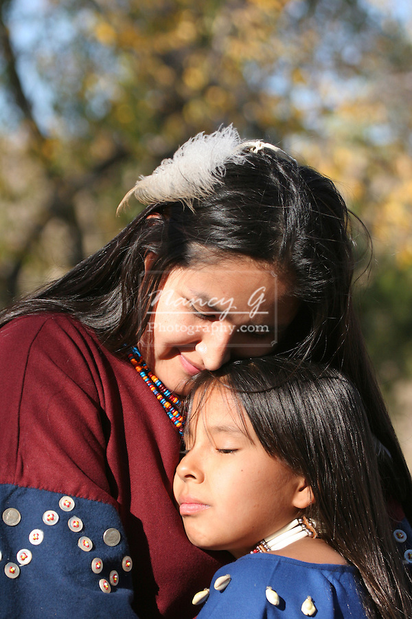 A Native American Indian woman hugging a child