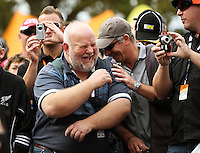 Spectators share a joke during Day Three of the Hamilton 400 Aussie V8 Supercars Round Two at Frankton, Hamilton, New Zealand on Sunday, 19 April 2009. Photo: Dave Lintott / lintottphoto.co.nz