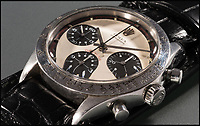 BNPS.co.uk (01202 558833)<br /> Pic: Phillips/BNPS<br /> <br /> A rare Rolex watch owned by the late movie star Paul Newman today sold for a world record &pound;13.5m.<br /> <br /> The legendary actor received the Rolex Cosmograph Daytona as a present from his wife Joanne Woodward in 1968. <br /> <br /> She bought the timepiece from the prestigious Tiffany &amp; Co store in New York and had it engraved with the message 'drive carefully' in light of her husband's fledgling motor racing career.<br /> <br /> Newman wore it daily for more than 15 years before passing it on to his daughter's then boyfriend, James Cox, while he stayed with the family one summer in the early 1980s<br /> <br /> It sold at Phillips Auctions of New York.