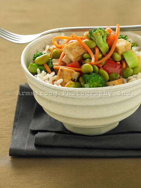 A bowl of veggie-tofu stir fry on top of white rice.