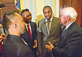 From left to right: American professional boxer and commentator Paulie Malignaggi;  American professional boxer and former WBA super welterweight champion Austin Trout; Phil Davis, former All American Wrestler & Bellator MMA fighter; and United States Senator John McCain (Republican of Arizona) share some thoughts following formal remarks at a press conference to discuss the observational study on the brain health of active and retired professional fighters on Capitol Hill in Washington, DC on Tuesday, April 26, 2016.  The study, led by researchers from the Cleveland Clinic, is  designed to better identify, prevent and treat Chronic Traumatic Encephalopathy (CTE.)<br /> Credit: Ron Sachs / CNP