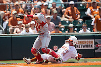 Houston Cougars catcher Caleb Barker (27) prepares to throw the ball to first after forcing Texas Longhorns base runner Ben Johnson (14) out at home during the NCAA Super Regional baseball game on June 7, 2014 at UFCU Disch–Falk Field in Austin, Texas. The Longhorns are headed to the College World Series after they defeated the Cougars 4-0 in Game 2 of the NCAA Super Regional. (Andrew Woolley/Four Seam Images)