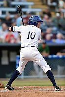Asheville Tourists right fielder Jordan Patterson #10 awaits a pitch during a game against the Savannah Sand Gnats at McCormick Field July 16, 2014 in Asheville, North Carolina. The Tourists defeated the Sand Gnats 6-3. (Tony Farlow/Four Seam Images)