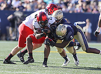 Annapolis, MD - September 23, 2017: Cincinnati Bearcats running back Gerrid Doaks (23) is tackled by several Navy Midshipmen defenders during the game between Cincinnati and Navy at  Navy-Marine Corps Memorial Stadium in Annapolis, MD.   (Photo by Elliott Brown/Media Images International)