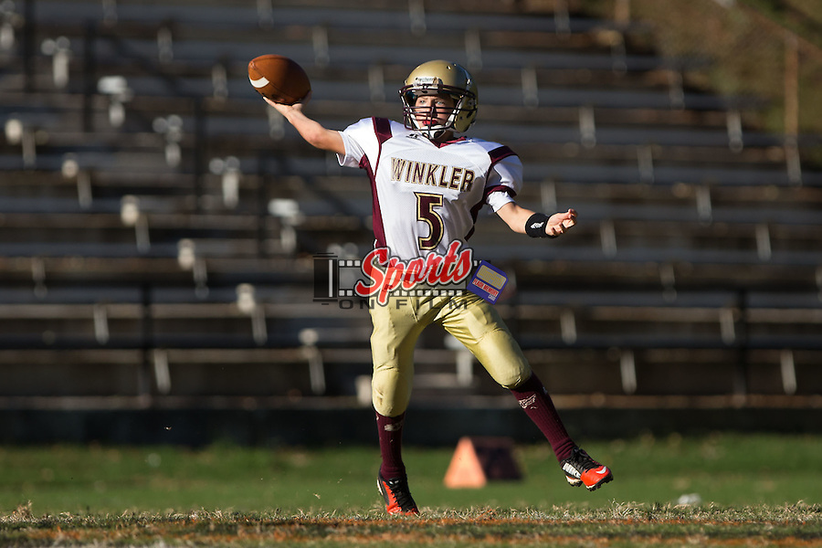 Winkler Wolves quarterback #5 passes the ball against the Northwest Cabarrus Titans in 7th grade football action at Trojan Stadium October 7, 2014, in Concord, North Carolina.  The Titans defeated the Wolves 58-30.  (Brian Westerholt/Sports On Film)