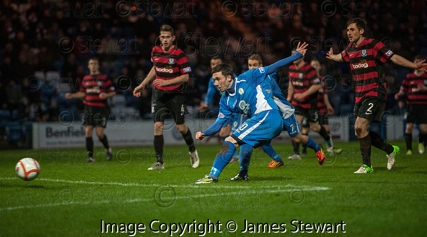 Queen of the South's Nicky Clark scores their second goal.