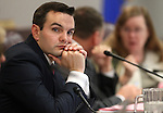 Nevada Assemblyman Derek Armstrong, R-Henderson, works in committee at the Legislative Building in Carson City, Nev., on Wednesday, March 18, 2015. <br /> Photo by Cathleen Allison