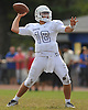 Oceanside quarterback No. 18 Vincent Guarino throws a pass during a Nassau County Conference I varsity football game against host East Meadow High School on Saturday, September 26, 2015. Oceanside won by a score of 14-7.<br /> <br /> James Escher