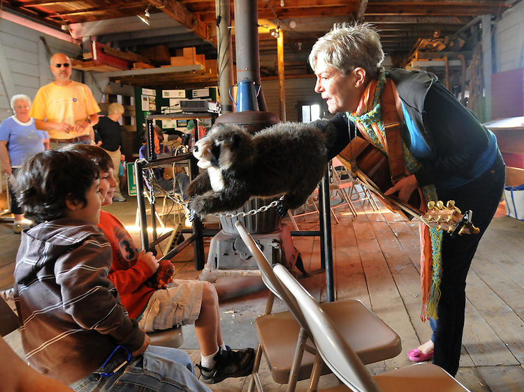 Lydia Adams Davis performing a program of Song and Puppetry aboard the Hudson Barge Pennsy 399 which is the site of a traveling exhibit promoting the Ecology of the Hudson River, the Barge was accompanying the Sloop Clearwater on it's Pumpkin Sail tour In Hudson, NY on Monday, October 10, 2011. Photo by Jim Peppler. Copyright Jim Peppler/2011.