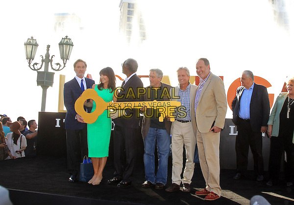 Kevin Kline, Mary Steenburgen, Morgan Freeman, Robert DeNiro, Michael Douglas, Jon Turteltaub, Carolyn Goodman<br /> &quot;Last Vegas&quot; cast received the key to Vegas at the Bellagio Fountain, Las Vegas, NV, USA, 18th October 2013.<br /> full length green dress jeans beige suit shirt blue fountains <br /> CAP/ADM/MJT<br /> &copy; MJT/AdMedia/Capital Pictures