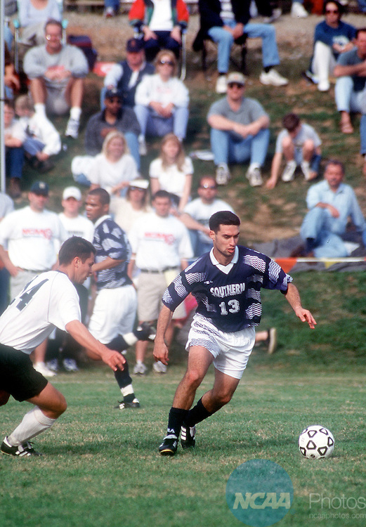 5 DEC 1998: Southern Connecticut State University midfielder Assaf Dagai (13) steers the ball away from University of South Carolina-Spartanburg midfielder Tuomas Tahvanainen (14) during the Division II Men's Soccer Championship held at Rifle Field in Spartanburg, SC. Southern Connecticut defeated South Carolina 1-0 for the championship title. Fred Rollison. Joanne Carole/NCAA Photos.