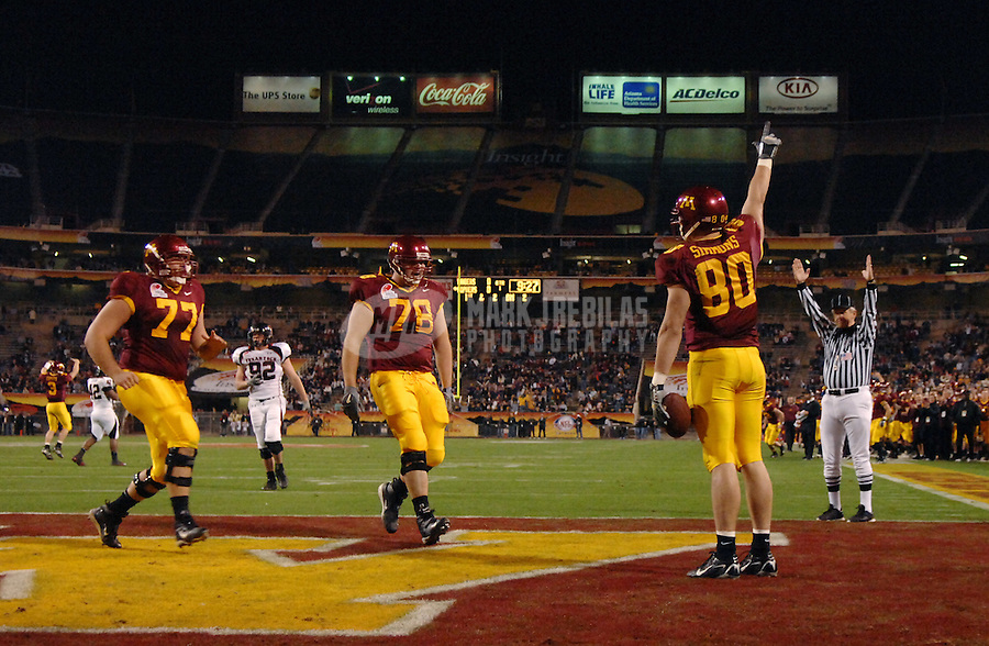 Dec 29, 2006; Tempe, AZ, USA;  Minnesota Golden Gophers tight end (80) Jack Simmons celebrates after scoring a touchdown against the Texas Tech Red Raiders in the first quarter during the Insight Bowl at Sun Devil Stadium in Tempe. Mandatory Credit: Mark J. Rebilas-US PRESSWIRE Copyright © 2006 Mark J. Rebilas....