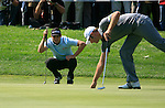 Martin Kaymer (GER) lines up his putt as Dustin Johnson (USA) lifts his ball from the hole on the 11th green during Day 2 of the BMW International Open at Golf Club Munchen Eichenried, Germany, 24th June 2011 (Photo Eoin Clarke/www.golffile.ie)