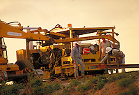 Track workers repairing track on Port Terminal Railroad - Port of Houston. Houston Texas USA Port of Houston.