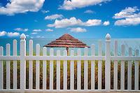 Fence and beach umbrella. Turks and Caicos. Providenciales