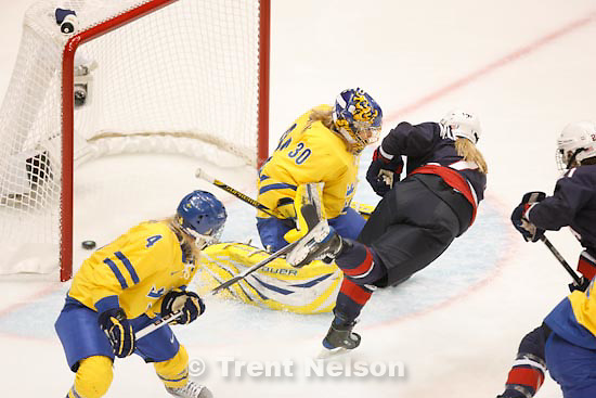Trent Nelson  |  The Salt Lake Tribune.USA's Monique Lamoureux scores on Sweden's Kim Martin, putting USA up 1-0 in the first period. USA vs. Sweden, women's hockey, at the XXI Olympic Winter Games in Vancouver, Monday, February 22, 2010.
