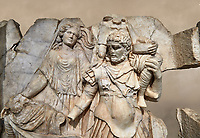 Close up of a Roman Sebasteion relief  sculpture of Aineas' flight from Troy, Aphrodisias Museum, Aphrodisias, Turkey.  Against an art background.<br /> <br /> Aineas in armour carries his aged farther Anchises on his shoulders and leads his young son Lulus by his hand. They are fleeing from the sack of Troy. The figure floating behind is Aphrodite, Aineas' mother: she is helping their escape. Old Anchises carries a round box that held images of Troy's ancestral gods.