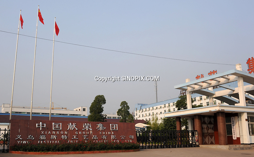 Yiwu Festival Gifts Co Ltd  factory in Yi Wu, China. The factory makes Christmas trees for UK retail giant B & Q. Yi Wu exports 40-50 % of the entire European Christmas decorations and 70 % of US and Mexico's Christmas gifts come from Yi Wu.