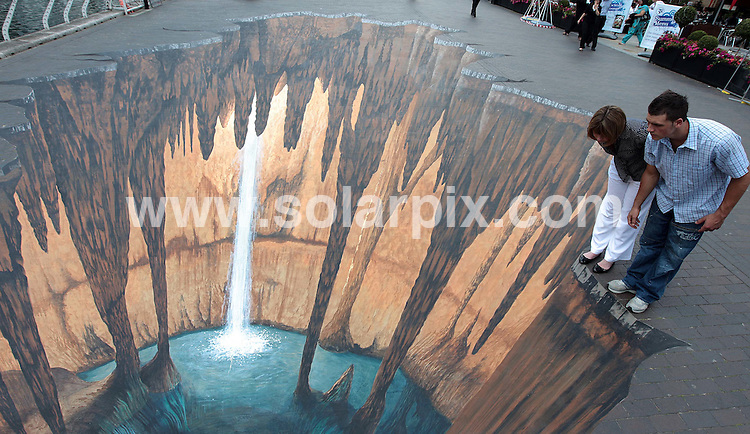 **ALL ROUND PICTURES FROM SOLARPIX.COM**.**NO UK NEWSPAPER PUBLICATION**.**UK MAGAZINE & SUPPLEMENT PUBLICATION ONLY** AND NO PUBLICATION IN AUSTRALIA, FRANCE, GERMANY, ITALY AND SCANDINAVIA** .A giant cave by renowned pavement artist Edgar Mueller has appeared in London Docklands this afternoon. The chalk drawing was commissioned by West India Quay who are currently running a 4 week programme of free art themed events and entertainment. Docklands, London, UK. 24 June 2009..This pic: Cave Art..JOB REF: 9326 SFE       DATE: 24_06_2009.**MUST CREDIT SOLARPIX.COM OR DOUBLE FEE WILL BE CHARGED**.**ONLINE USAGE FEE GBP 50.00 PER PICTURE - NOTIFICATION OF USAGE TO PHOTO @ SOLARPIX.COM**.**CALL SOLARPIX : +34 952 811 768 or LOW RATE FROM UK 0844 617 7637**