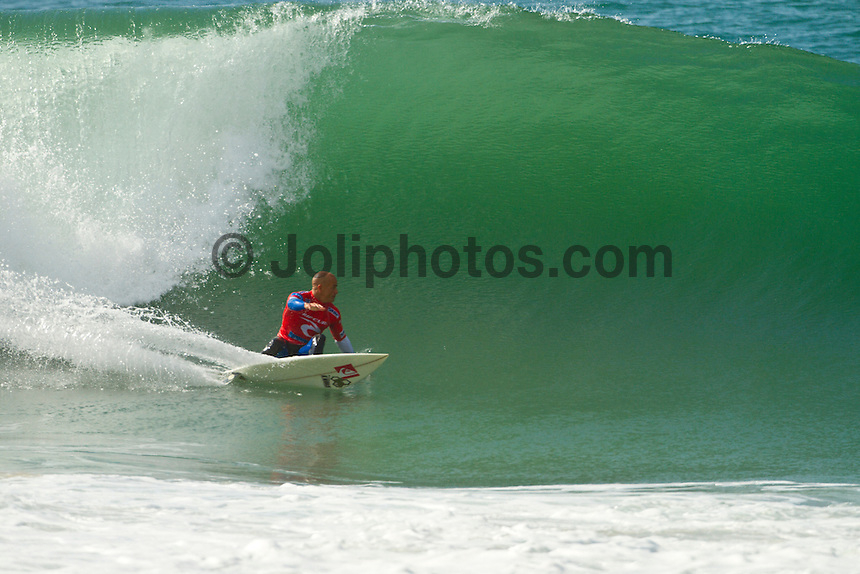 """SUPERTUBOS, Peniche/Portugal (Thursday, October 14, 2010) -Kelly Slater (USA), 38, former nine-time ASP World Champion and current ASP World No. 1, has collected his 44th elite tour victory, besting current ASP World No. 2, Jordy Smith (ZAF), 22, to take out the Rip Curl Pro Portugal in glassy three-to-five foot (1.5 metre) waves at Supertubos.. .Event No. 8 of 10 on the 2010 ASP World Tour, the Rip Curl Pro Portugal played a vital role in the hunt for the 2010 ASP World Title and was privy to some of the most high-performance surfing the world has ever seen.. .Although composed and relatively under-the-radar throughout the Rip Curl Pro Portugal, Slater struck stealthily in the Final, locking in two solid backhand waves in the shifting conditions, and staving off a late charge from the young South African.. .""""It was actually a pretty slow Final with neither of us getting any waves of consequence,"""" Slater said. """"I was trying to stay busy but neither of us could get a solid wave. I actually nearly ended up reaching my wave maximum out there so I kind of had to slow down and try to wait for waves that mattered. Jordy (Smith) has all the talent in the world and he's capable of getting a score at any time. It wasn't over until the horn blew."""". .En route to an unprecedented 10th ASP World Title, the iconic Floridian moves one step closer to clinching, with a strong possibility of doing so in the upcoming event...Photo: joliphotos.com"""