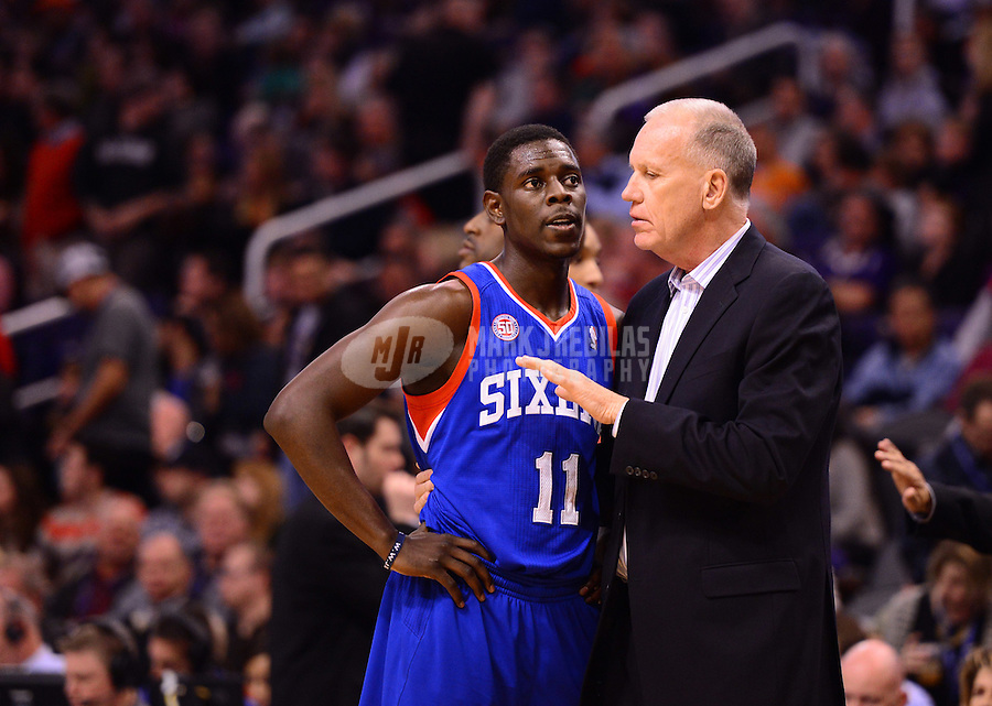Jan. 2, 2013; Phoenix, AZ, USA: Philadelphia 76ers guard Jrue Holiday (11) talks with head coach Doug Collins during a time out in the first half against the Phoenix Suns at the US Airways Center. Mandatory Credit: Mark J. Rebilas-USA TODAY Sports