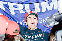 """Robert Herrera, of Bronx, New York, shouts his support for Trump near TV cameras on 6th Avenue outside the Midtown Hilton on Tues., Nov. 8, 2016. The election night victory rally for Republican presidential nominee Donald Trump was held at the hotel later that night. The race was called for Trump in the early hours of Nov. 9. Herrera was leading a group of people who started demonstrating their support for the candidate outside Trump Tower earlier that day and then walked to the Hilton and around Midtown Manhattan. The group shouted slogans such as """"Drain the Swamp"""" and """"Latinos for Trump"""" as they walked along the sidewalks of midtown Manhattan."""