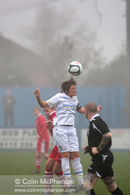 Leeds United Ladies FC midfielder Clare Sykes heading the ball, during the first half against Nottingham Forest Ladies FC in an FA Premier League National Division fixture at the Throstle Nest, Farsley, West Yorkshire. The match ended in a one-all draw, watched by fewer than 50 spectators at the club's regular home ground. Formed in 1989, Leeds United Ladies has been one of England's top women's sides for most of the last ten years and played in the top winter league for ladies' teams.