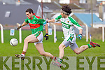 Jeremiah King of Beal breaks away from John Enright of Ballydonoghue in the Division 4/5 play off in Ballylongford GAA grounds last Sunday