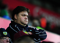 A Burnley fan watches on during the game<br /> <br /> Photographer Ashley Crowden/CameraSport<br /> <br /> The Premier League - Swansea City v Burnley - Saturday 10th February 2018 - Liberty Stadium - Swansea<br /> <br /> World Copyright &copy; 2018 CameraSport. All rights reserved. 43 Linden Ave. Countesthorpe. Leicester. England. LE8 5PG - Tel: +44 (0) 116 277 4147 - admin@camerasport.com - www.camerasport.com