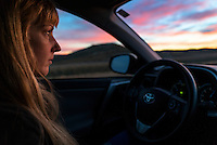 A woman drives as dawn breaks in eastern Montana.