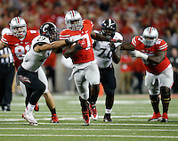 Ohio State Buckeyes running back Rod Smith (7) rushes past Cincinnati Bearcats cornerback Aaron Brown (7) and defensive lineman Brandon Mitchell (70) during the fourth quarter of the NCAA football game at Ohio Stadium in Columbus on Sept. 27, 2014. (Adam Cairns / The Columbus Dispatch)