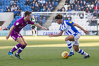 Stefan Scougall of Carlisle United tries to prevent Courtney Senior of Colchester United from making attacking progress during Colchester United vs Carlisle United, Sky Bet EFL League 2 Football at the JobServe Community Stadium on 23rd February 2019