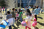 Kids scramble during an egg hunt at 7th Annual Easter Fiesta at Western Nevada College Saturday, March 26, 2016. The event, hosted by the Association of Latin American Students, had 3 separate egg hunts, face painting, limbo, musical chairs, ring toss, sack races, bowling,  food, music and a piñata.  <br />