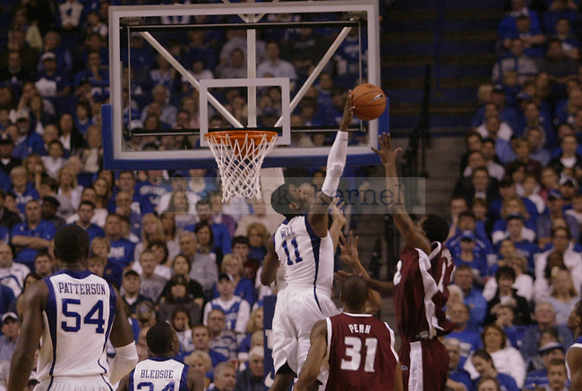 University of Kentucky freshman guard John Wall blocks a shot from Rider forward Mike Ringgold in the second half of UK's 92-63 win over Rider on Nov. 21, 2009 in Lexington, Ky...Ed Matthews | Staff