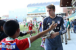 06 August 2014: Bayern Munich's Leopold Zingerle (GER) (right) hands his gloves to a young fan at then end of pregame warmups. The Major League Soccer All-Stars played Bayern Munich of the German Bundesliga at Providence Park in Portland, Oregon in the 2014 MLS All-Star Game. The MLS All-Stars won the game 2-1.