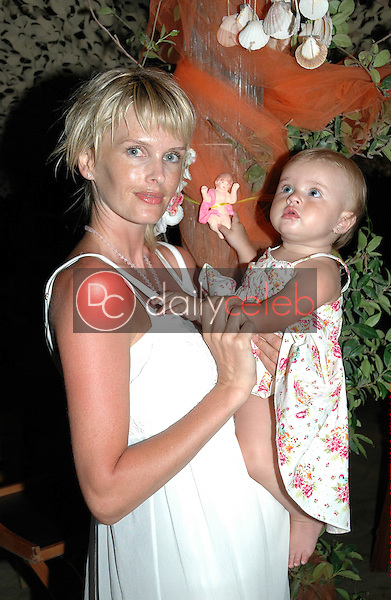 Kylie Bax and daughter Lito Vassiliki Poros on the beach in Panormos, Greece, on the night of Kylie's wedding to Spiros Poros, and the baptism of her daughter.<br /> <br /> Photo by DailyCeleb.com 818-249-4998<br /> <br /> <br /> EXCLUSIVE       EXCLUSIVE        EXCLUSIVE