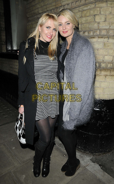 Nancy Sorrell & Morgana Robinson.attended the Hot Valve Leak: Visual Ramblings of Vic Reeves paintings & collages exhibition private view, Strand Gallery, London, England..February 12th, 2013.full length black grey gray mohair jacket coat tights quilted bag purse top white polka dot diamond pattern print pinafore dress boots coat jacket  .CAP/CAN.©Can Nguyen/Capital Pictures.