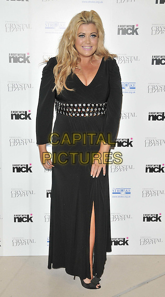 """Gemma Collins.The """"A Night With Nick"""" charity event in aid of The Stroke Association, Swarovski CRYSTALLIZED, Gt. Marlborough St., London, England..December 6th, 2011.full length black dress clutch bag beads beaded slit split.CAP/CAN.©Can Nguyen/Capital Pictures."""