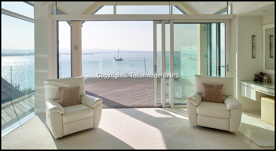BNPS.co.uk (01202) 558833<br /> Pic: Tailormade/BNPS<br /> <br /> Stunning harbour views across to the Isle of Purbeck.<br /> <br /> Stunning super home for sale - If you've got £9 million to spare...<br /> <br /> This state of the art mega-home is for sale on the exclusive millionaires playground of Sandbanks in Poole, Dorset.<br /> <br /> The biggest, most expensive, and luxurious home ever to come on the market on the tiny peninsula, it is now selling for a cool £8.75m.<br /> <br /> Called The Moorings, the harbour front mansion has stunning sea views, and is on one of the most enviable plots on Millionaire's Row.<br /> <br /> Its owners, entrepreneur Chris Thomas and wife Sue, spent a staggering £5.5m building the palatial home that has been compared to a five star hotel.<br /> <br /> Spread over 13,000 sq ft - the equivalent size of seven detached houses - the state-of-the art property comes with five en suite bedrooms, three reception rooms, an office, cinema room, indoor swimming pool, sauna, gym, gate house and boat house.