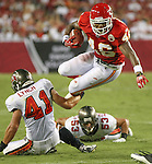 Kansas City Chief's running back Tim Castille leaps forward for a first down against the Tampa Bay Buccaneers. The Buccaneers defeated the Chiefs  20-15 during an NFL preseason game Saturday, Aug. 21, 2010 in Tampa,Fla. (AP Photo/Margaret Bowles)