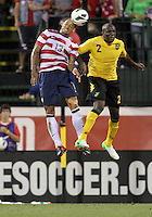 COLUMBUS, OHIO - SEPTEMBER 11, 2012:  Jermaine Jones (13) of the USA MNT up for a header with Nyron Nosworthy (2) of  Jamaica during a CONCACAF 2014 World Cup qualifying  match at Crew Stadium, in Columbus, Ohio on September 11. USA won 1-0.
