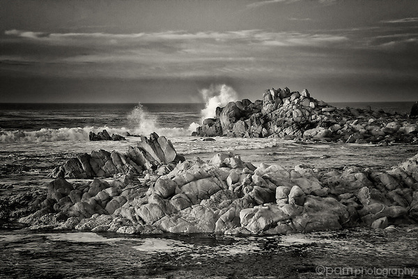 Sea crashing into rocks along the shoreline of Monterey, California.  Taken in infrared