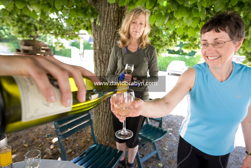 Betsy Athan (R) and Leigh Lightfoot, participants in a Backroads cycle tour of the Loire Valley, taste wine at the Chateau de Nitray in Athee-sur-Cher, France, 25 June 2008.